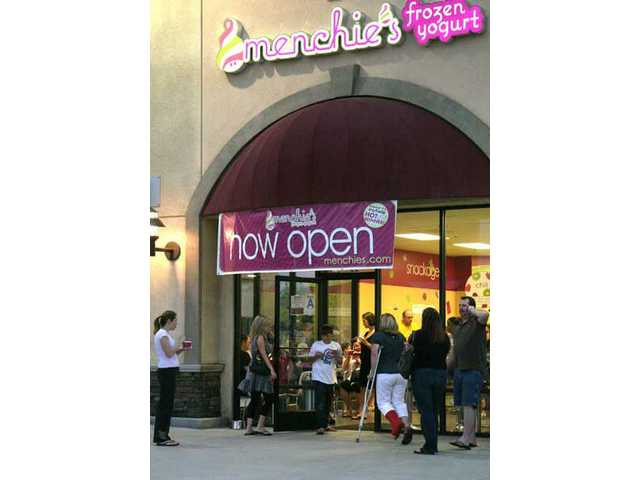 Open now, the new Menchie's frozen yogurt store in Newhall will throw a grand opening celebration Saturday noon to 5 p.m. in the Riverview Plaza shopping center at Sierra Highway and Via Princessa in Newhall.