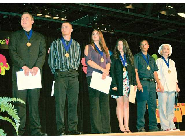 Gold medalists, from left to right, Michael Wright, Dalton Bond, Rachel Ward, Jasmin Robles, Edger España and Austyn Walline, stand on stage at the ROP awards ceremony.