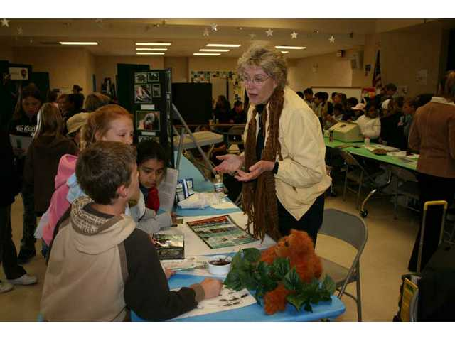 Experts in environmental careers and on environmental issues attended Rio Vista Elementary School's Environmental Awareness Day last month. Here children learn about orangutans, which are endangered due to the destruction of their environment.