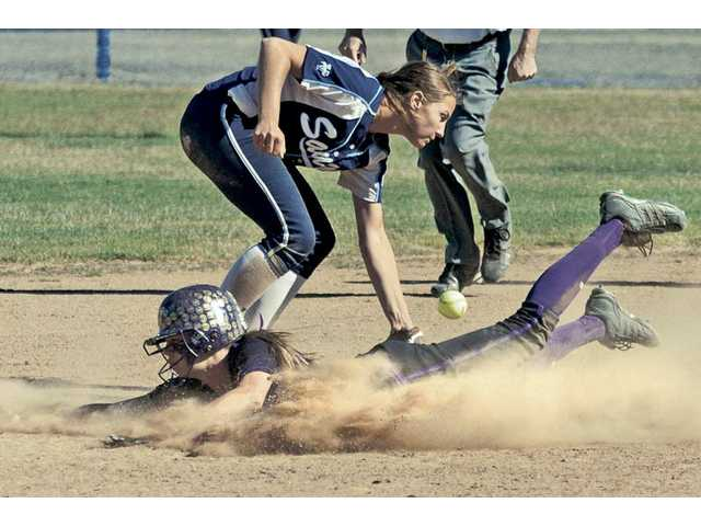Valencia's Madison Shipman, bottom, slides safely into second base past Saugus' Jenna Kelly on Tuesday at Saugus High School. Valencia won the game 1-0.
