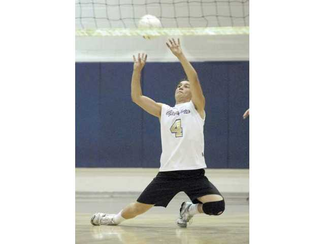 Valencia junior setter Jason Halliday (4) dives for a serve against Hart on March 31 at Valencia High.