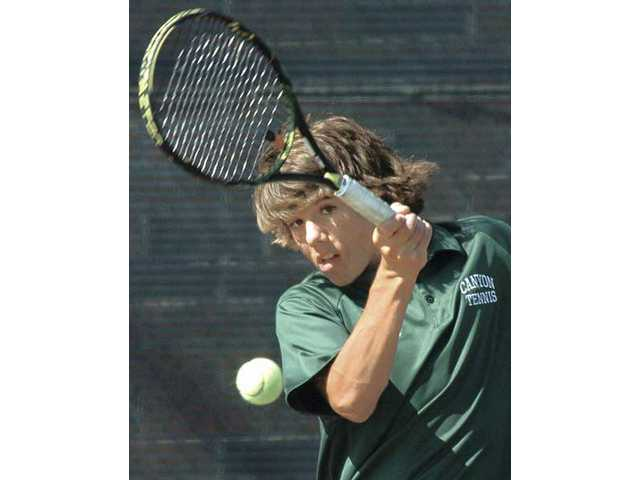 Canyon tennis player Matt Kincaid returns a shot Tuesday at Canyon High in a match in the CIF-Southern Section Division II wild card against South Pasadena. Canyon lost 10-8.