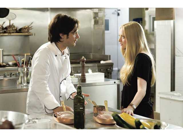 "Amanda Seyfried, right, and Gael Garcia Bernal are shown in a scene from ""Letters to Juliet."""