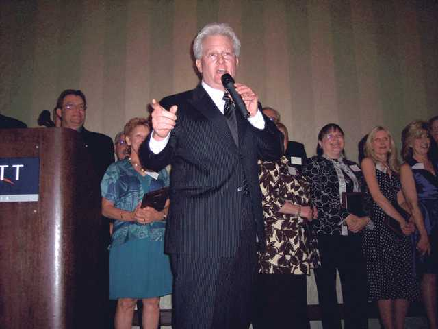 "Crooner Bill Lively sings ""It Had to Be You"" before singing out the names of the 2009 Man and Woman of the Year."