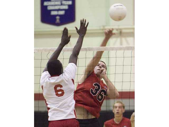 Julian Rodriguez (36) skies above the net against Hueneme Wednesday at Hart.