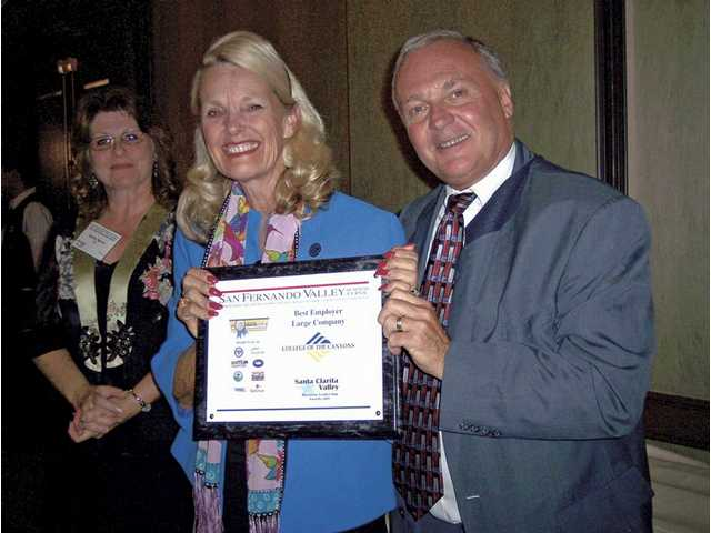 From left to right, Valley Industrial Association President Kathy Norris, College of the Canyons Chancellor Dianne Van Hook and SCV Chamber of Commerce President Larry Mankin. College of the Canyons was named the Best Large Employer in the Santa Clarita Valley.