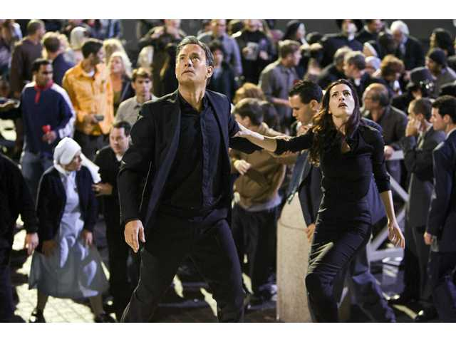 "Tom Hanks and Ayelet Zurer, right, are shown in a scene from the Dan Brown thriller ""Angels & Demons."""
