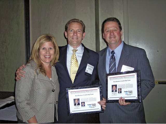 ity Councilwoman Laurie Ender, left, stands with David Poole and John Shaffery who won Best Team Leadership Award at the Santa Clarita Valley Business Leadership Awards 2009 at the Hyatt Valencia on Wednesday.