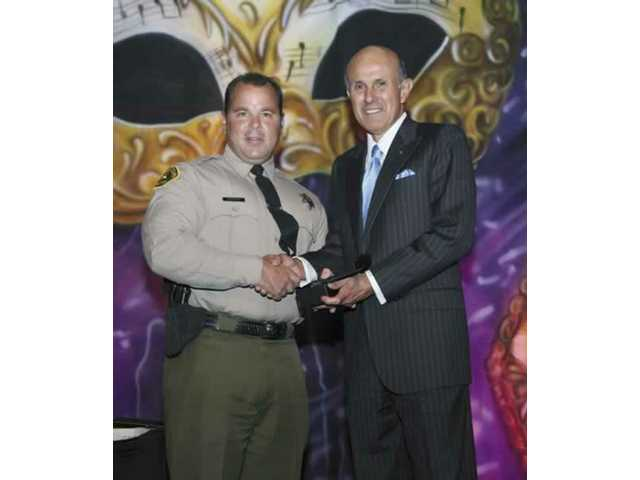 "Deputy Timothy Ferrone receives his award as ""VIDA Deputy of the Year"" in April."