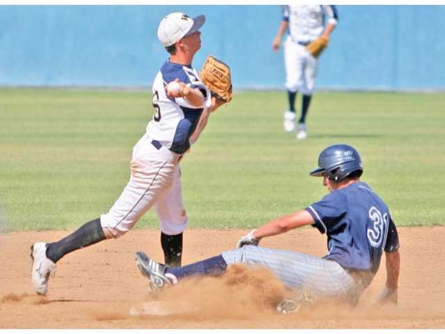 West Ranch senior shortstop Randy Poe, left, attempts to turn a double play as Saugus senior Scott Lombardi slides into second base during Friday afternoon's game at West Ranch. West Ranch beat Saugus 12-7.