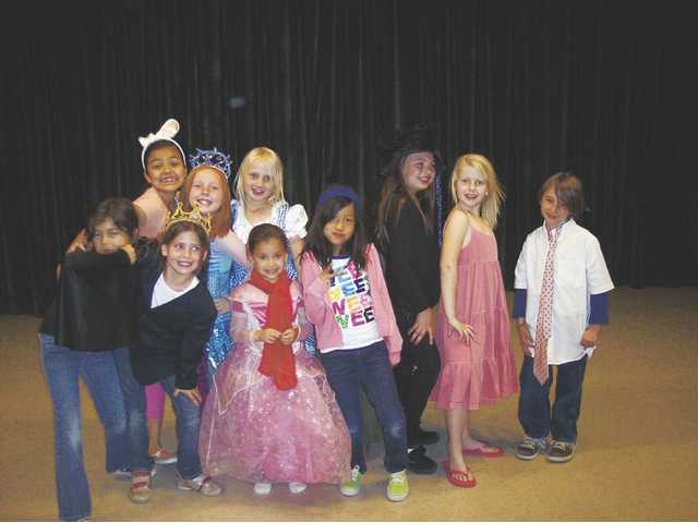 "The cast of ""Little Princess in Wonderland"" gather for a photo before the show was performed at Fair Oaks Community School in Canyon Country. Left to right, front: Leah Cerdedez, Megan Ballou, Nichelle Perkins, Dana Saulo, Jazmine Trevizo, Emily Holmes and Jimmy Warshawsky. Back row: Kiara Gunn, Lauren Ballou and Maggie Scherer. Not pictured: Chloe Mendoza."