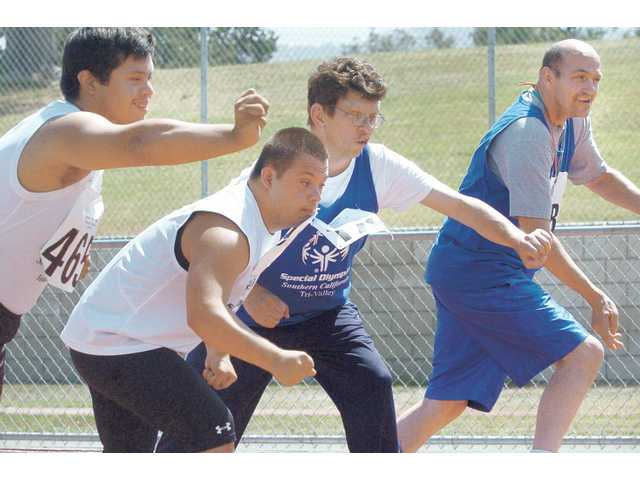 From left, Nicolas Sanord, Michael Agular, Scott Hinmin and Byron Bushong fire off the starting line of a 100-meter race at the Special Olympics, which was held at Hart High School, Newhall Park, Placerita Junior High School and the Boys & Girls Club on Saturday.