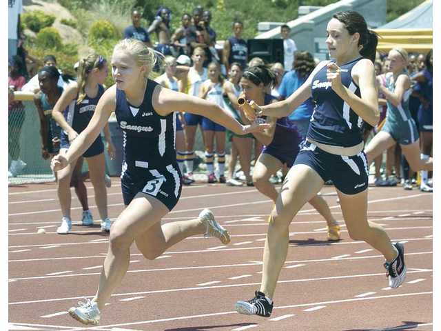 Saugus' Jamie Molacek, left, takes the handoff from Jenna Vincej in the girls 4X100-meter relay Saturday at the CIF-Southern Section Division II Track and Field Prelims at Moorpark High.
