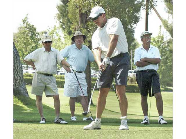 "Rajinder Kaushal, left, Bryan George and David Mysko watch as Jim Pietsch drives off the 10th tee at the 36th annual Frontier Toyota/Henry Mayo Newhall Memorial Hospital ""Drive Safe"" golf tournament at Valencia Country Club on Saturday. Proceeds from the event will benefit Emergency and Trauma Services at Henry Mayo Newhall Memorial Hospital."