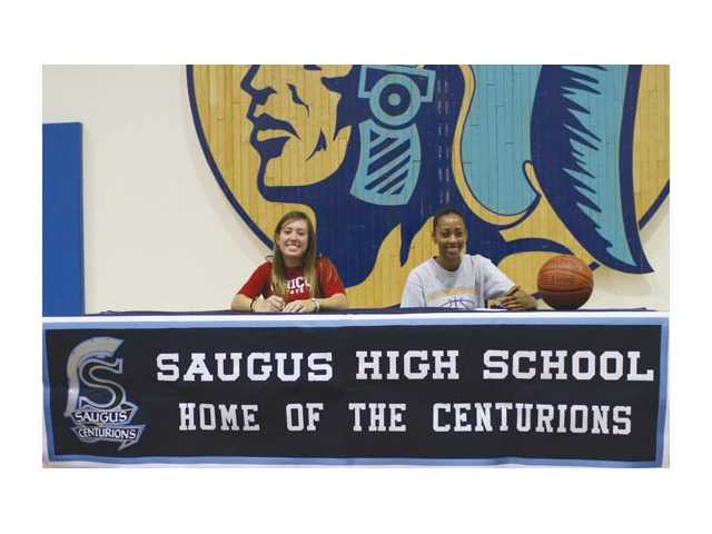 Saugus senior golfer Tiara Wells, left, and senior basketball player Nicole Hicks, right, sign their collegiate letters of intent Tuesday at Saugus High.