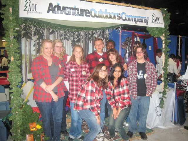 The Adventures Outdoors Company team from Academy of the Canyons visits Bakersfield for a trade fair where it came in first place for its catalogue and website. Back row, from left to right, Stephanie Adkison, Brittany Hynes, Katie Simon, Xavier-Quinn Roman, Claire Titcomb, Vivean Muna, Daniel Hartmann. Front row, Sophia Weiss and Nandinee Rajyagor.