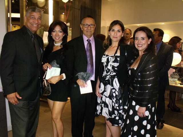 Bill Miranda, president/founder, and Bob Pacheco, board member, visit with family and friends at the SCV Latino Chamber of Commerce's VIP cocktail night on April 30.