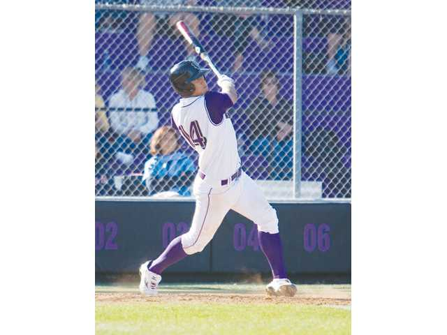 Valencia shortstop Christian Lopes hits the ball against Hart on April 3 at Valencia High.