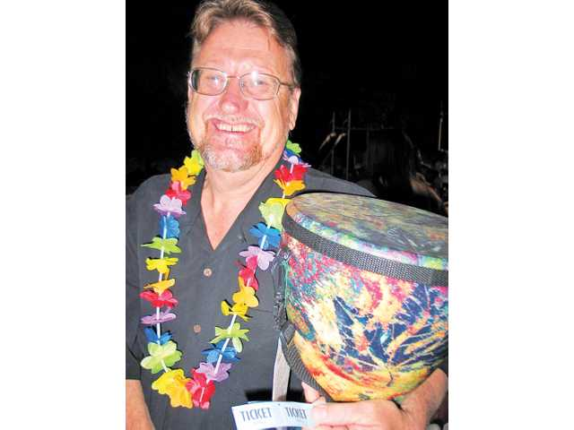 TimBen Boydston won the 100 percent organic hemp REMO Eco-Drum with a Monet-like hand-painted design. He said he will present the drum to his daughter.