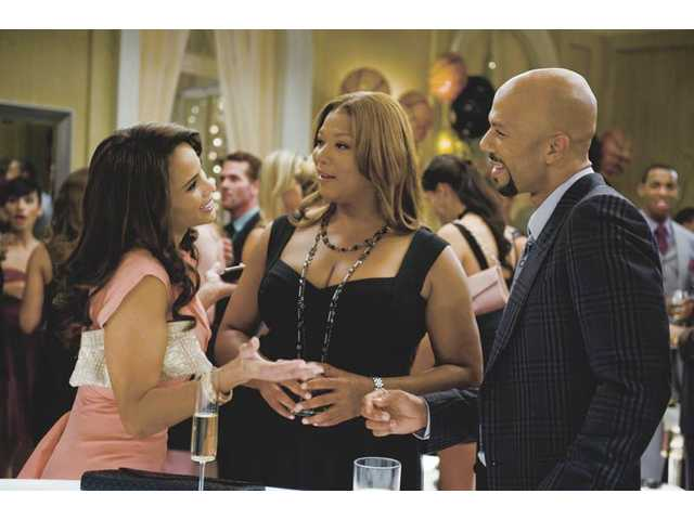"Paula Patton, left, Queen Latifah, and Common are shown in a scene from ""Just Wright."""