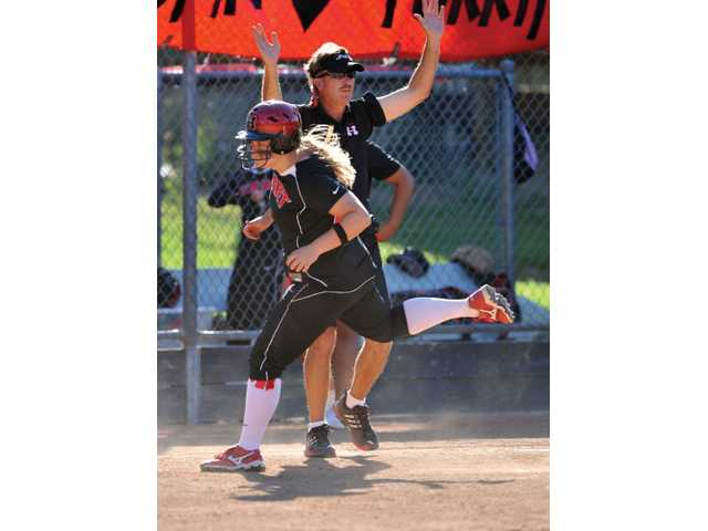 Hart head coach Steve Calendo sends in Caitlyn Zimmerman in the ninth inning of the CIF-SS Div. I playoffs at Newhall Park.