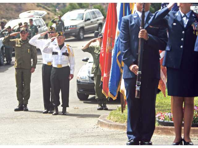 Veterans salute the American Flag during the 2008 Memorial Day Tribute to Veterans at Eternal Valley Memorial Park.