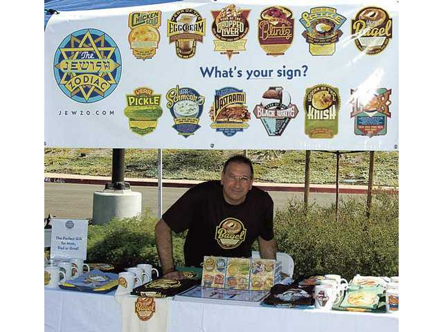 Seth Front, owner of Jewish Zodiac -a Jewish store based in West Hills - sits behind one of the many booths at the event.