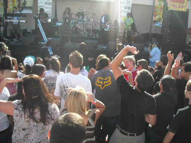 Fans dance as Kounterfiet Changes rocks the Summer Meltdown VI concert at Golden Valley High Saturday, May 23.
