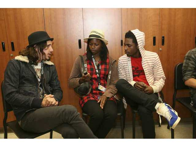 Shwayze (right) and Cisco Adler (left) talk with the authorin the duo's dressing room backstagenear the end ofthe Summer Meltdown concert at Golden Valley High Saturday, May 23.