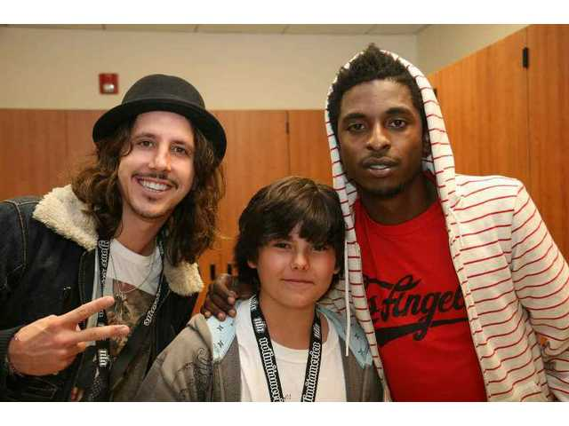 "Johnny Flinn (center) of Valencia got to meet headliner Shwayze (right) and Shwayze's partner Cisco Adler (left) backstage Saturday night. The Bridgeport Elementary sixth-grader won the Racer's Edge ""Summer Meltdown Ultimate Giveaway"" contest on Thursday."