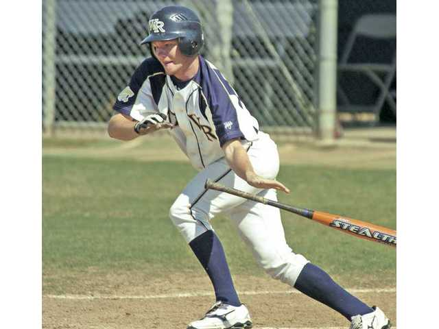 West Ranch's Trevor Fredrickson burst out of the batters box in a game against El Dorado at West Ranch Friday.