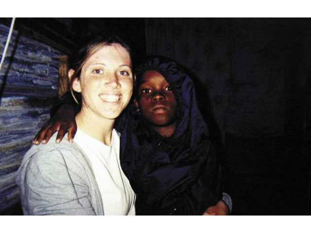 Jennifer Ginsberg (left), of Church of the Canyons, is pictured with a youngster she worked with during a 2000 mis-sion to South Africa. She will leave June 5 for Senegal to aid young boys.