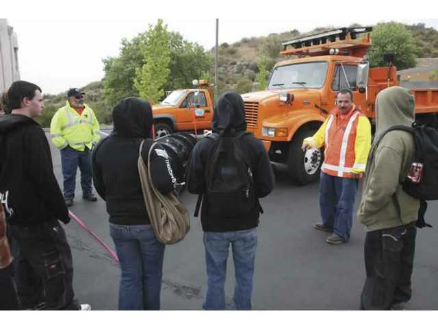 Caltrans Operator Benny Godinez (middle right) speaks to students about his job.