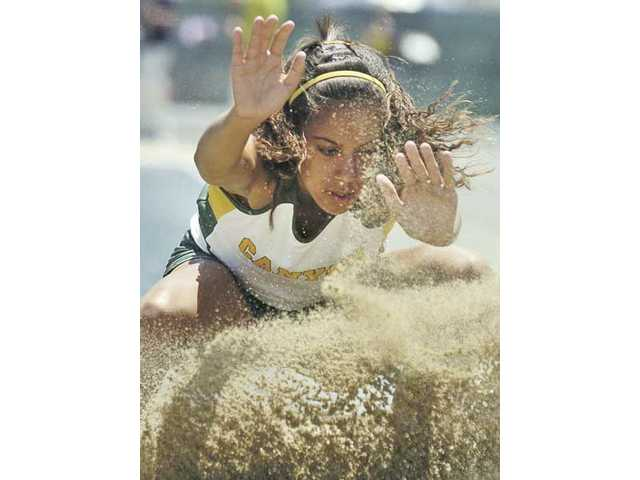 Canyon's Tiffini Stone competes in the long jump at the CIF Track and Field Championships Saturday at Cerritos College. The freshman took third in the event with a jump of 17 feet, 9 3/4 inches.