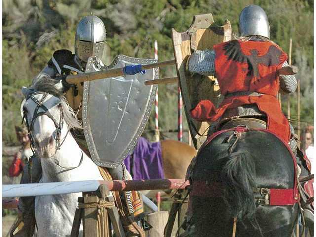 """Members of the American Jousting Alliance, Ariana Machado, left, on her horse Brutus, and James Zoppe, """"Sir James, The Red Knight"""" on his horse Iron, execute a joust for the audience at the Frazier Mountain Spring Jousting Tournament and Fair at Tait Ranch and Trout Farm on Saturday."""