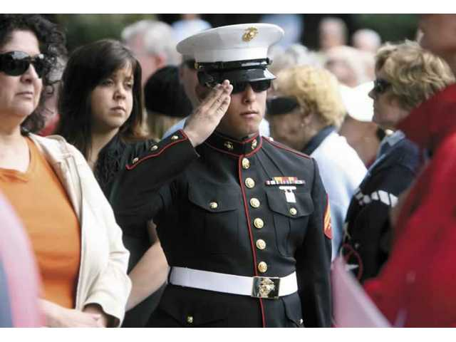 Steven Leon, 21, of Saugus, who returned from Iraq on May 13, salutes the American flag during the ceremony.