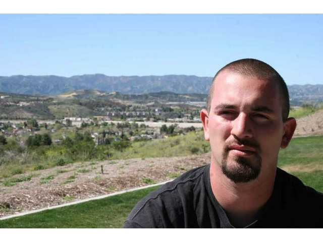 "Jason ""Spike"" Zigler soaks up the view of Canyon Country and the Santa Clarita Valley from Todd Longshore Park as he talks about his two years in the Army, and tour in Iraq."