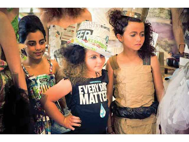 Left to right, designer Analisse Villasenor, 9, model Chloe Sawyer, 10, and model Taylor Hoffman, 9.