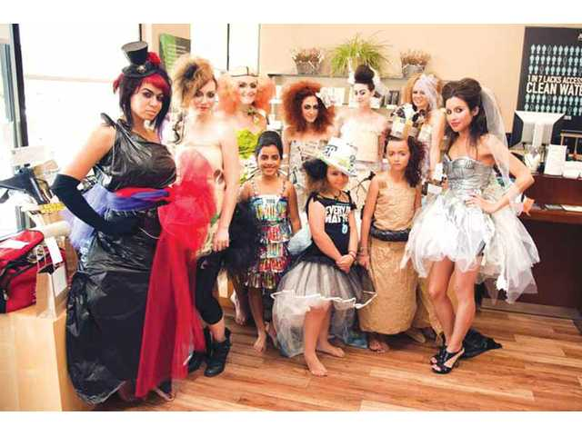 Dressed to impress awareness on the crowd of salon guests, models gathered to strike a pose in their runway recyclables. Top row, left to right: Shannon Hoffman, Lena Hardesty, Paige Sheldrick, Courtney Zerangue, Emily Largey and Sarah Lochett; bottom row, left to right: Annalisse Villasenor, Chloe Sawyer, Taylor Hoffman and Bonnie Zavala.