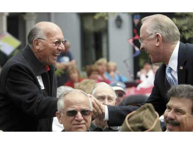 "War veteran Jerry Schauer, left, a resident of Belcaro, shakes hands with Congressman Howard ""Buck"" McKeon on Monday afternoon."