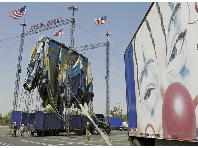 Circus Vargas workers unfurl the huge circus tent-canopy in the Westfield Town Center parking lot on Tuesday. The circus opens Thursday and runs through June 7. Tickets start at $15 for children and $20 for adults.