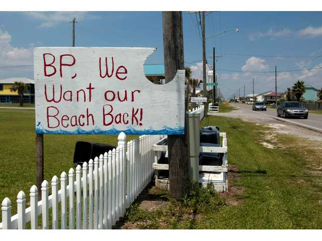 A sign protesting the oil spill and BP is shown in Grand Isle, La., Thursday, May 27, 2010.