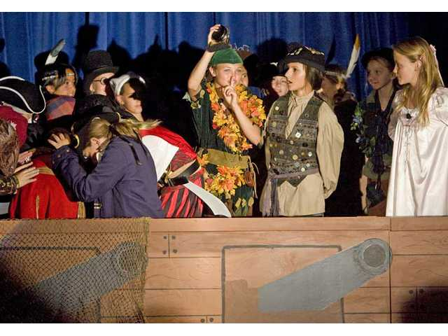 "Peter Pan, played by sixth-grader Avery Schulhofer, tricks Captain Hook and his pirates with a ticking-hand clock during a scene from ""Peter Pan the Musical."" The Rosedell Drama Club is performing  the play Thursday and Friday at 6 p.m., and Saturday at noon."
