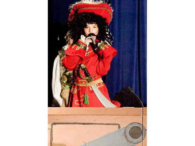 "Captain Hook, played by sixth-grader Nathan Lindsay, sings and dances about being a villain during the Rosedell Drama Club presentation of ""Peter Pan the Musical"" at Rosedell Elementary School for Tuesday morning's dress rehearsal."