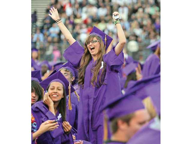 Valencia High School graduate Amanda Rompal reacts after spotting her family and friends in the stands during Wednesday's commencement ceremony at College of the Canyons' Cougar Stadium. Valencia graduated 542 seniors. Rompal said she plans to attend COC next year.