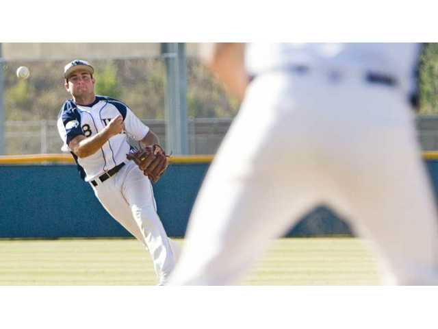 West Ranch shortstop Cal Vogelsang makes a throw to first base Tuesday in the CIF-SS Division I baseball playoffs at West Ranch High. The Wildcats lost 13-1 to Edison of Huntington Beach.