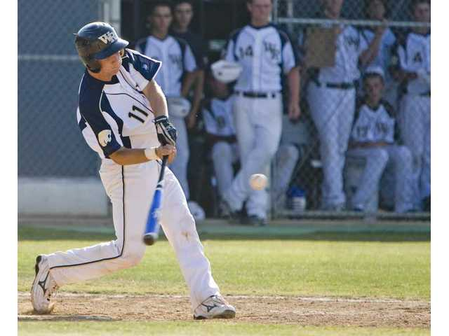 West Ranch catcher Max Blaha swings at a pitch Tuesday at West Ranch High in the CIF-Southern Section Division I baseball playoffs.