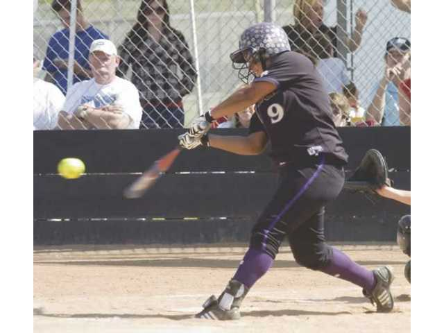 Valencia High's Jessica Spigner belts her second home run (a solo shot in the third inning) of the CIF-Southern Section Division I semifinal game at Santiago High School. Spigner hit and pitched her club to a 3-2 victory and a berth in the title game.