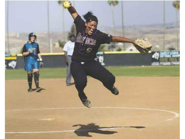Valencia High pitcher Jessica Spigner jumps for joy after making a catch to record the last out of the CIF Division I semifinal contest against Santiago on Tuesday. Spigner belted two home runs and pitched a complete game 3-2 victory.