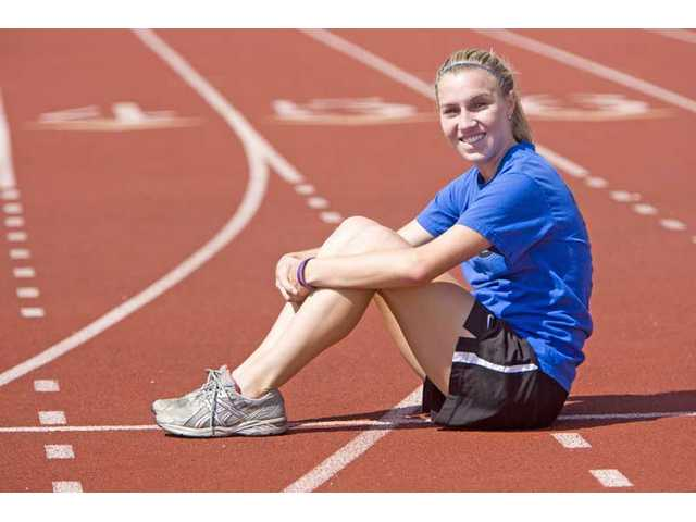 Valencia High senior runner Aly Drake sits on the track at the school Wednesday. Drake, the CIF-Southern Section Division I champion, will compete in the 800-meter race in Friday's CIF-Southern Section Masters Meet at Cerritos College.